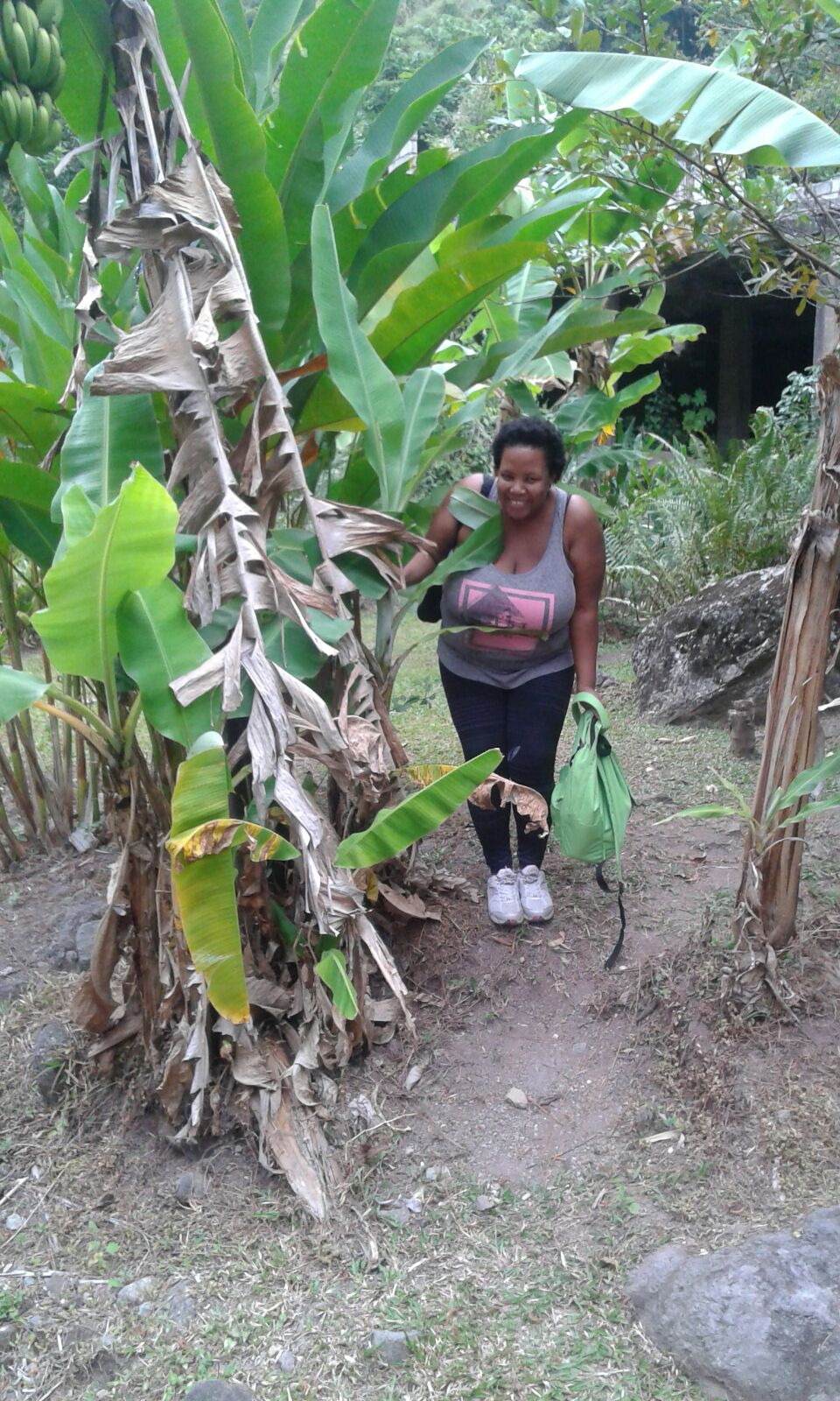 The Dryland Tourist behind a banana tree after hiking in Jamaica