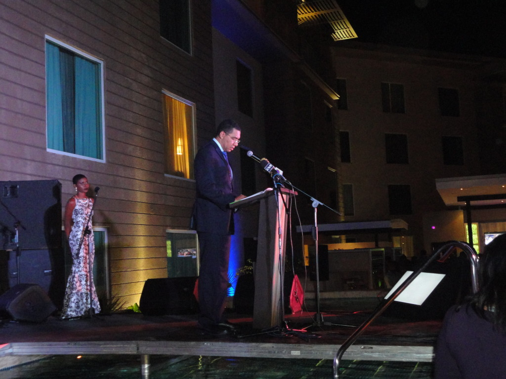 """Prime Minister Andrew Holness with Host and Vlogger Toni """"Bella"""" Blair at Courtyard by Marriott"""